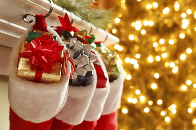 Christmas stockings in front of a  blurred Christmas tree.To see more holiday images click on the link below: