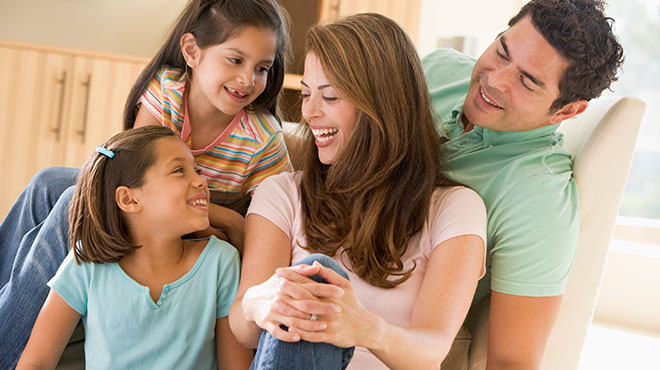 Happy hispanic family in their living room