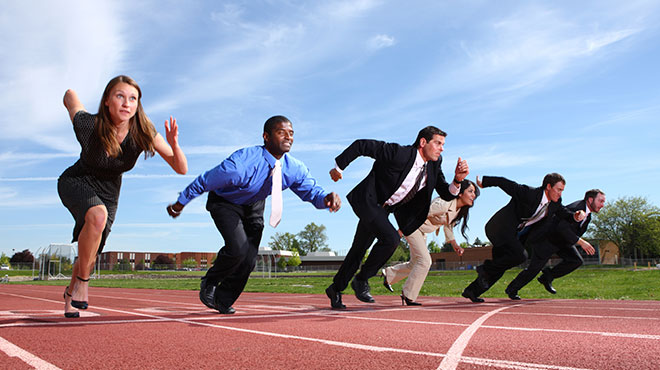 Business executives in a running track taking off