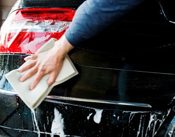 Washing a car with sponge..