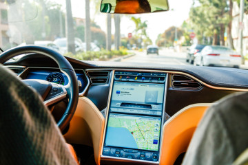 Los Angeles, United States - May 17, 2013: A cockpit with LCD digital speedometer and steering wheel of electric car Tesla Model S during drive. Tesla electric cars are produced by Tesla Motors, Inc. in California, USA.