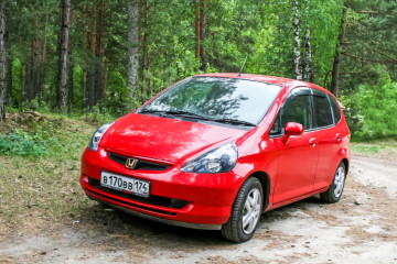 MIASS, RUSSIA - JUNE 12, 2009: Motor car Honda Fit in the forest.