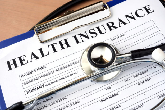 Close up of health insurance form with stethoscope