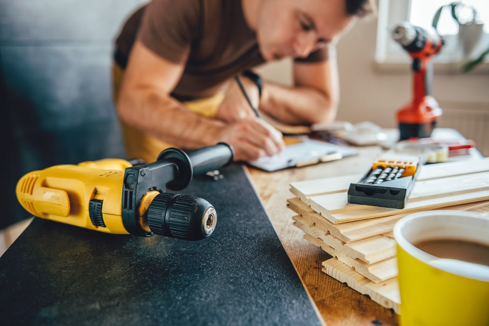 man updating floors while staying inside