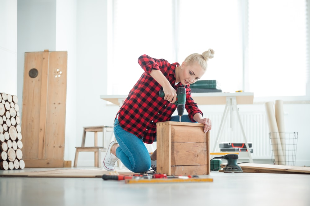 woman doing a diy home project while staying inside