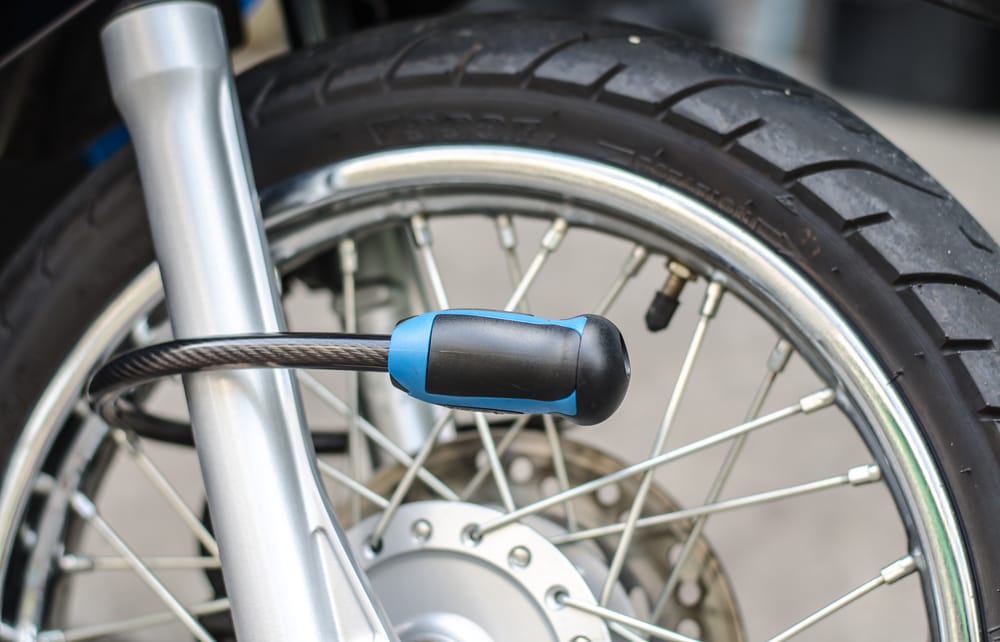 anti theft lock attached to motorcycle wheel
