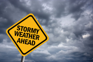 sign that says stormy weather ahead prepare for a storm