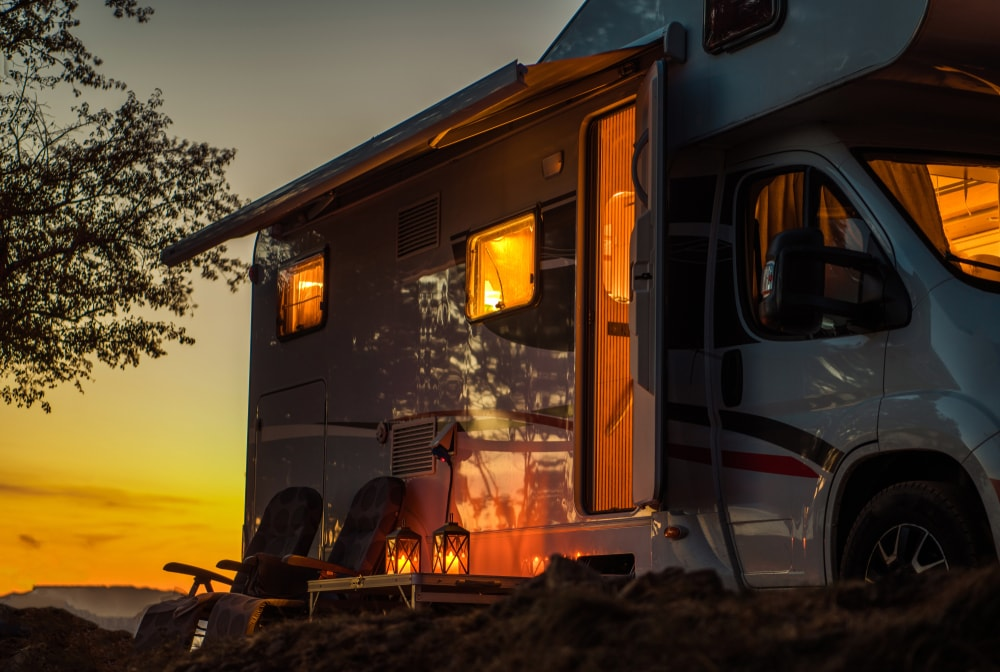 used camper parked during a sunset
