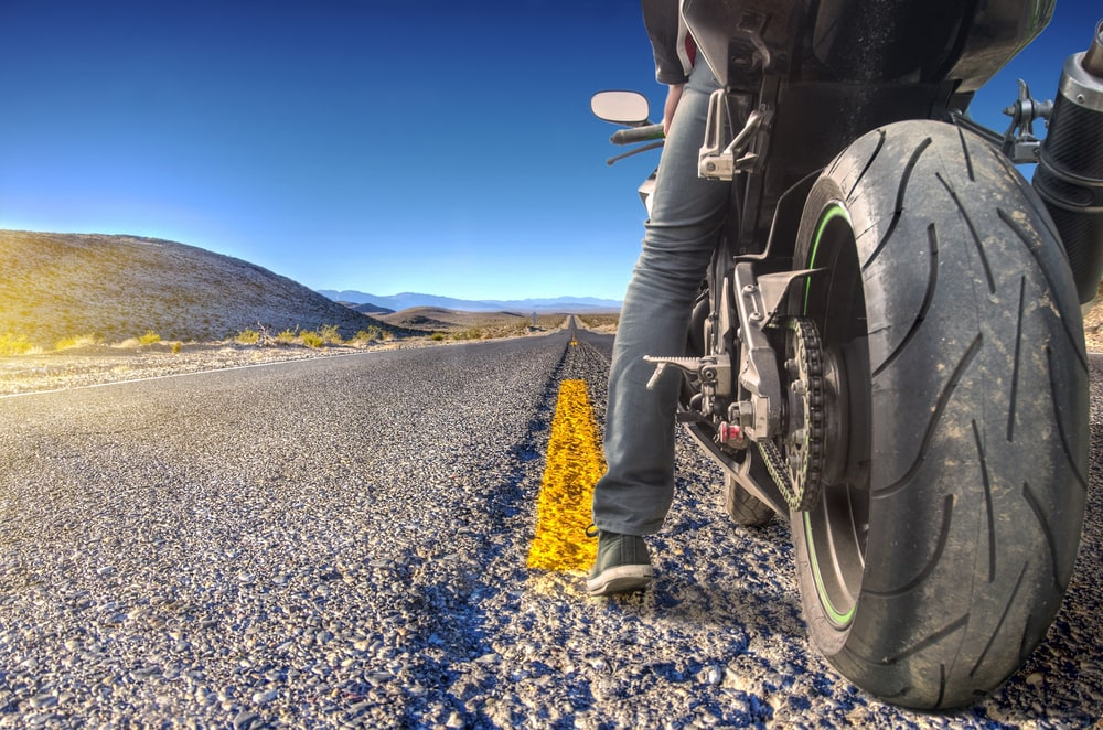 back view of motorcycle rider in california with insurance