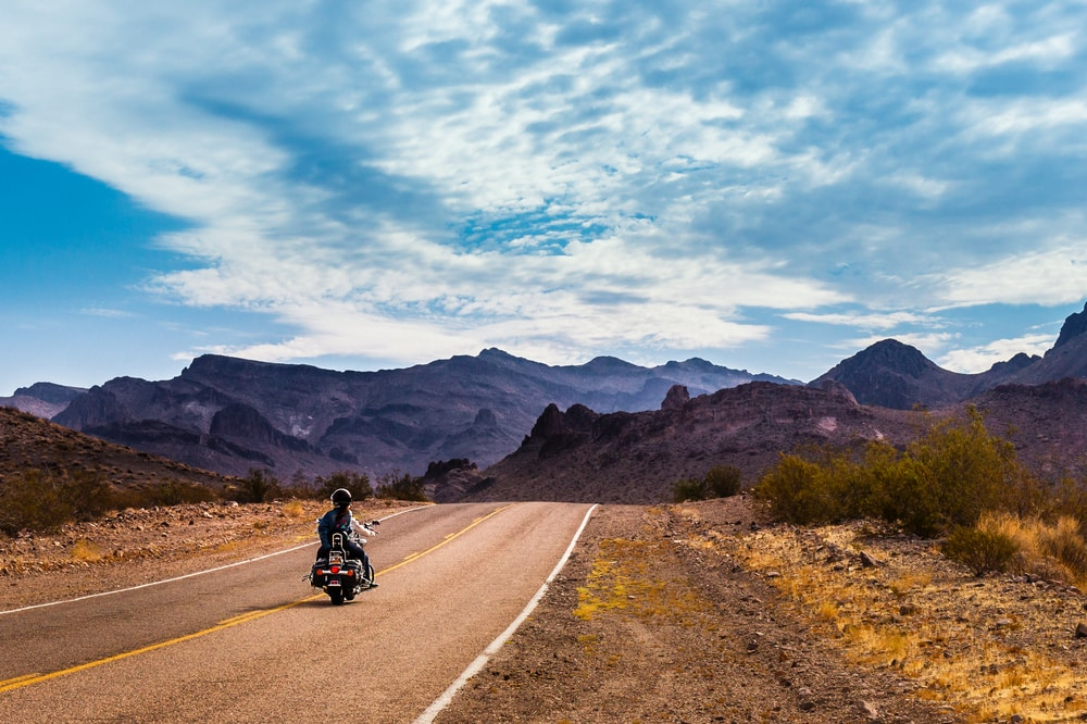 panoramic view of california road with a motorcycle