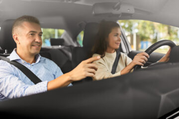 couple in car driving with car insurance
