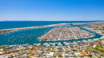 Aerial view of coast with boats in Newport Beach harbor, California