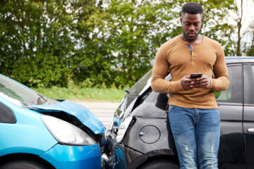 Male Motorist Involved In Car Accident Calling Insurance Company