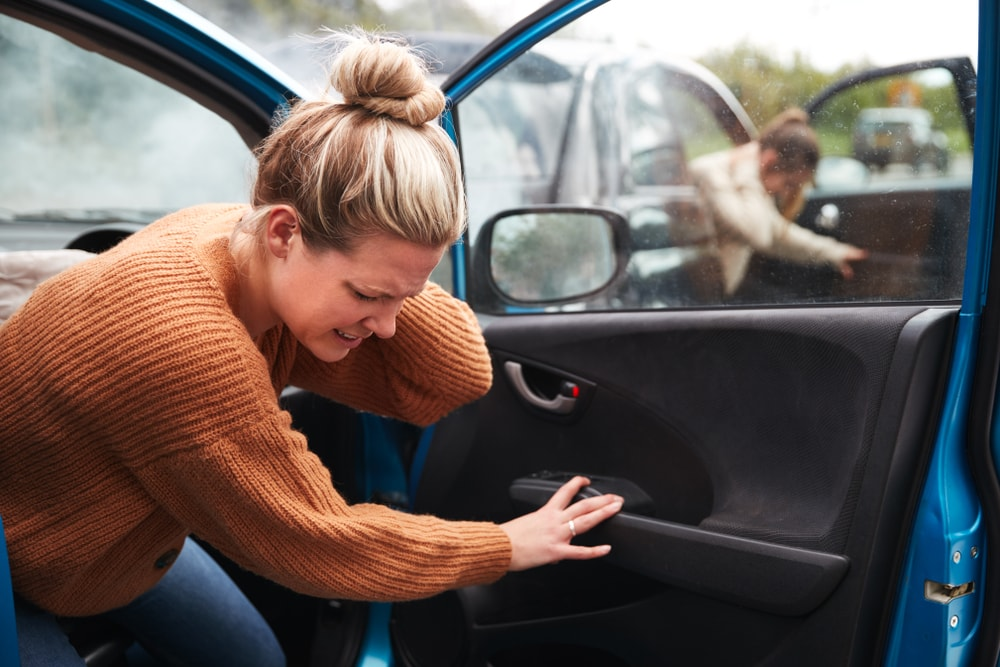 Female Motorist In Crash For Crash Getting Out Of Car without insurance