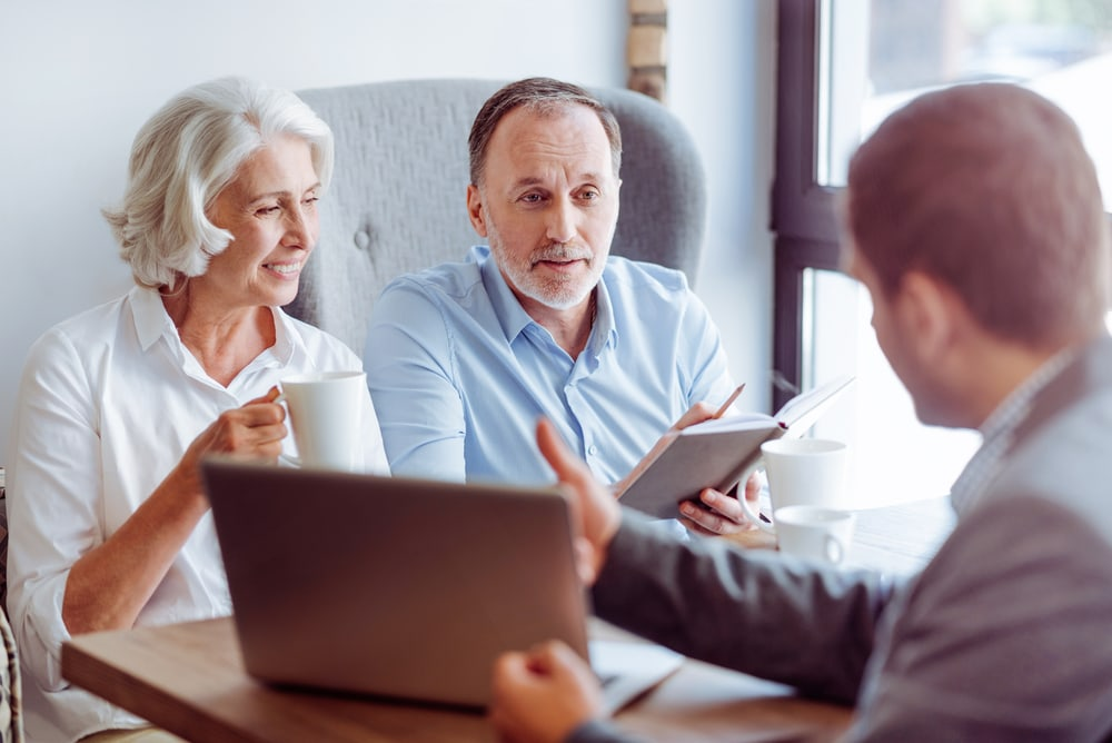 older couple with car insurance agent